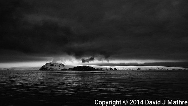 Dark clouds at dawn (02:48 AM) over King George Island. From the deck of the Hurtigruten MS Fram. Image taken with a Leica T camera and 23 mm f/2 lens (ISO 100, 23 mm, f/2.8, 1/125 sec). (David J Mathre)