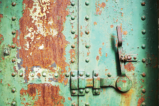 Closed rusty green steel door in concrete bunker, Artillery Hill, Fort Warden State Park, Port Townsend, Washington, USA (Brad Mitchell)