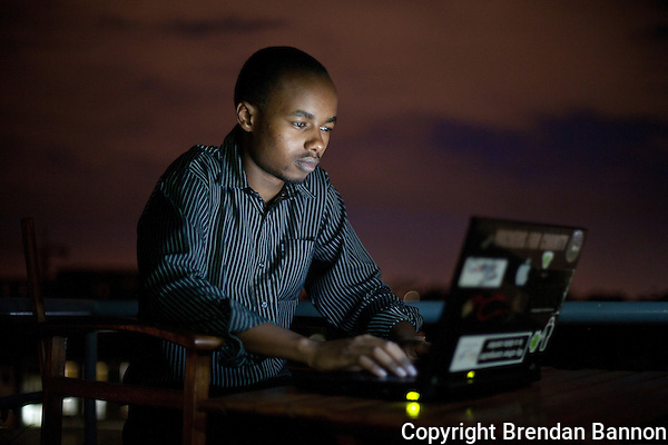 Sammy Njoroge, a mobile app developer at work in Nairobi, Kenya's i-Hub, a creative space for technology incubation where fast internet speeds attract like minded professionals working on mobile, computer and sms applications. (Photographer: Brendan Bannon)