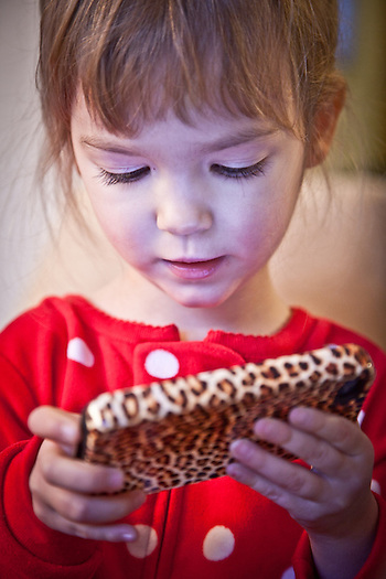 Adalyn Hatch with leopard iPhone, Anchorage (Clark James Mishler)