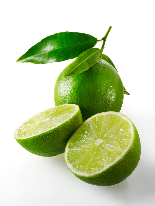Fresh whole and cut lime fruit with leaves (Paul Williams)
