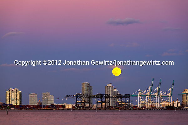 The full moon rises over the Port of Miami, Florida and Miami Beach condo buildings in the background on October 29, 2012. (&copy; 2012 Jonathan Gewirtz / jonathan@gewirtz.net)