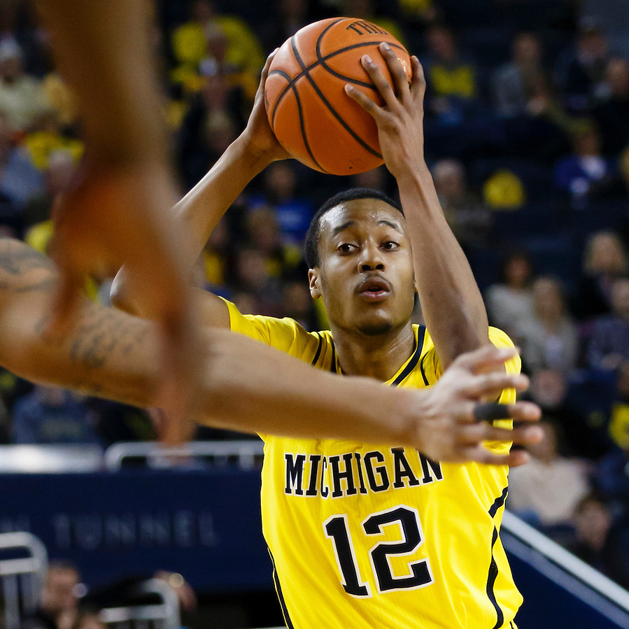 Feb 22, 2015; Ann Arbor, MI, USA; Michigan Wolverines guard Muhammad-Ali Abdur-Rahkman (12) looks to pass in the first half against the Ohio State Buckeyes at Crisler Center. Mandatory Credit: Rick Osentoski-USA TODAY Sports (Rick Osentoski/Rick Osentoski-USA TODAY Sports)