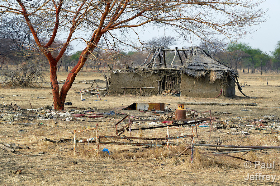 The remains of a partially-destroyed house in Mijak, a village in the contested Abyei region from which residents fled in 2011 after an attack by soldiers and militias from the northern Republic of Sudan. Although the 2005 Comprehensive Peace Agreement called for residents of Abyei--which sits on the border between Sudan and South Sudan--to hold a referendum on whether they wanted to align with the north or the newly independent South Sudan, the government in Khartoum and northern-backed Misseriya nomads, excluded from voting as they only live part of the year in Abyei, blocked the vote and attacked the majority Dinka Ngok population. The African Union has proposed a new peace plan, including a referendum to be held in October 2013, but it has been rejected by the Misseriya and Khartoum. The Catholic parish of Abyei, with support from Caritas South Sudan and other international church partners, has maintained its pastoral presence among the displaced and assisted them with food, shelter, and other relief supplies. (Paul Jeffrey)