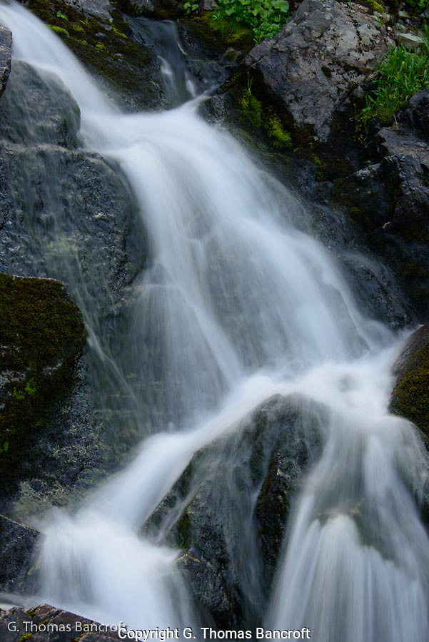 The water tumbled down the rock face creating a wonderful soothing sound.  I sat on a moss covered rock for a long time just enjoying the music. (G. Thomas Bancroft)