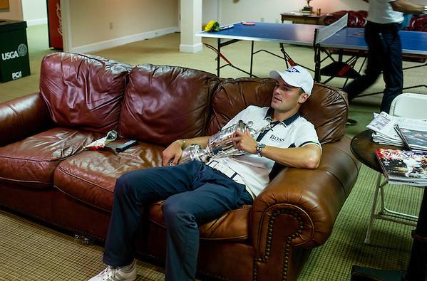 U.S. Open Champion Martin Kaymer rests for a moment with the trophy after the final round of the 2014 U.S. Open at Pinehurst Resort & C.C. in Village of Pinehurst, N.C. on Sunday, June 15, 2014.  (Copyright USGA/Darren Carroll) (Darren Carroll/USGA Museum)