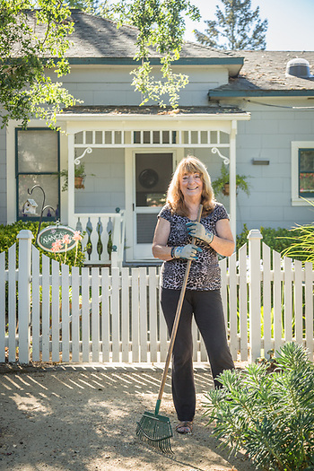 Nanci Smith sweeps up in front of her home in Calistoga (Clark James Mishler)