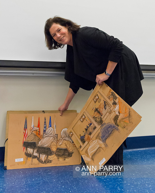 """""""Hempstead, NY, U.S. November 12, 2013. Janet Hamlin, a courtroom artist covering the military tribunals at Guantanamo Bay since 2006, shows her charcoal drawings and discusses her work at Hofstra University. Much of the time she was the only journalist providing a visual record of the events at the United States naval base in Cuba, and her new book"""