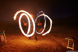 Cherie Ve Ard dances with fire in the Anza Borrego desert of California. (Seth K Hughes)