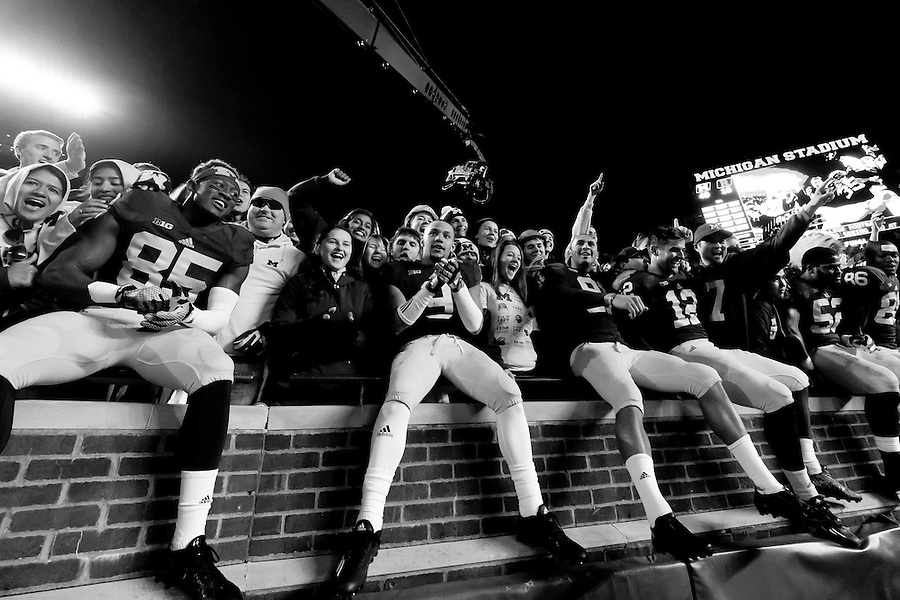 Nov 7, 2015; Ann Arbor, MI, USA; Michigan Wolverines players celebrate in the student section after the game against the Rutgers Scarlet Knights at Michigan Stadium. Michigan won 46-16. Mandatory Credit: Rick Osentoski-USA TODAY Sports (Rick Osentoski/Rick Osentoski-USA TODAY Sports)