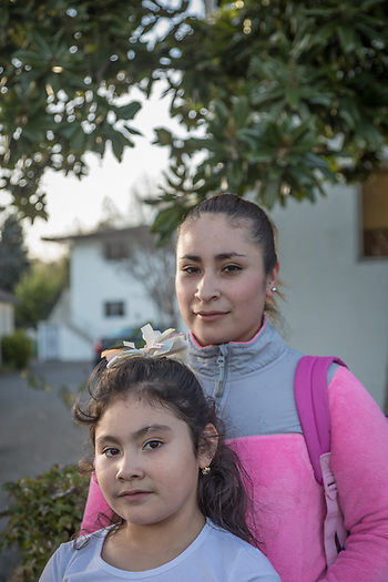 """I want to attend college and study child development...it's never too late.""  -Ivonne Sandoval walks home with her seven year old daughter, Leslie, on Third Street in Calistoga (Clark James Mishler)"