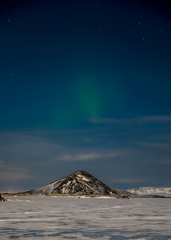 MÝVATN, ICELAND - CIRCA MARCH 2015: Aurora Borealis, also known as Northern Lights over Mývatn during winter time. This is a popular tourist destination in Iceland. (Daniel Korzeniewski)