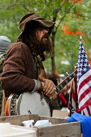 Protester taking a break from playing Banjo during a Occupy Wall Street demonstration in Zuccotti Park. October 21, 2011. (Emon Hassan)