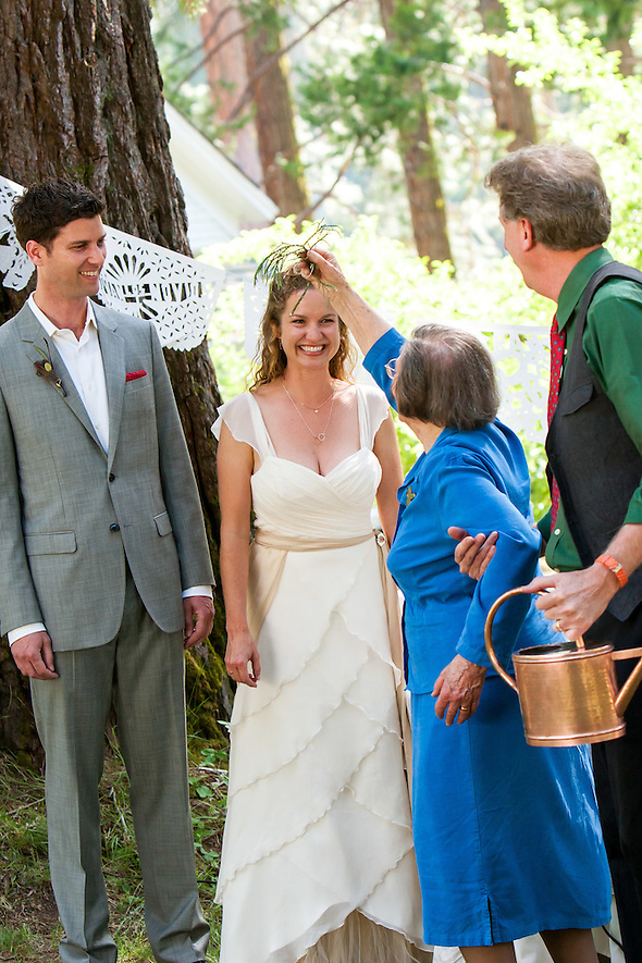 Muriel, Marshall's grandmother, waters the plant, and sprinkles some on the couple as well at breidi and Marshall's wedding in Wawona, CA, on June 16, 2012. (Sha Sha Chu)