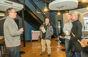 Robbie Goldsmith, director of community engagement at the Nashville Entrepreneur Center, explains the benefits of membership to Danny Dunn, Jase Tillman, and Brittany Lipscomb, Jan. 6, 2015, in Nashville, Tenn. The Entrepreneur Center has become the nucleus of a burgeoning startup movement — largely led by Millennials — in the city. (Photo by Carmen K. Sisson/Cloudybright) (Carmen K. Sisson/Cloudybright)