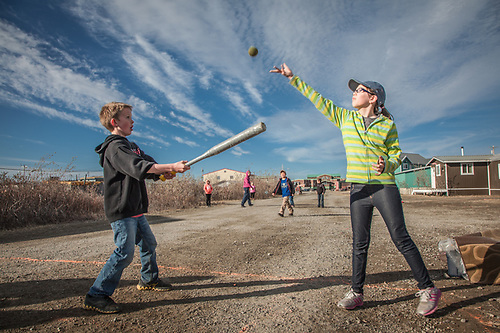 "Kids playing ""Lapp Game"" on the dirt streets of Kotzebue, The Purchase Centennial Poject (Clark James Mishler)"