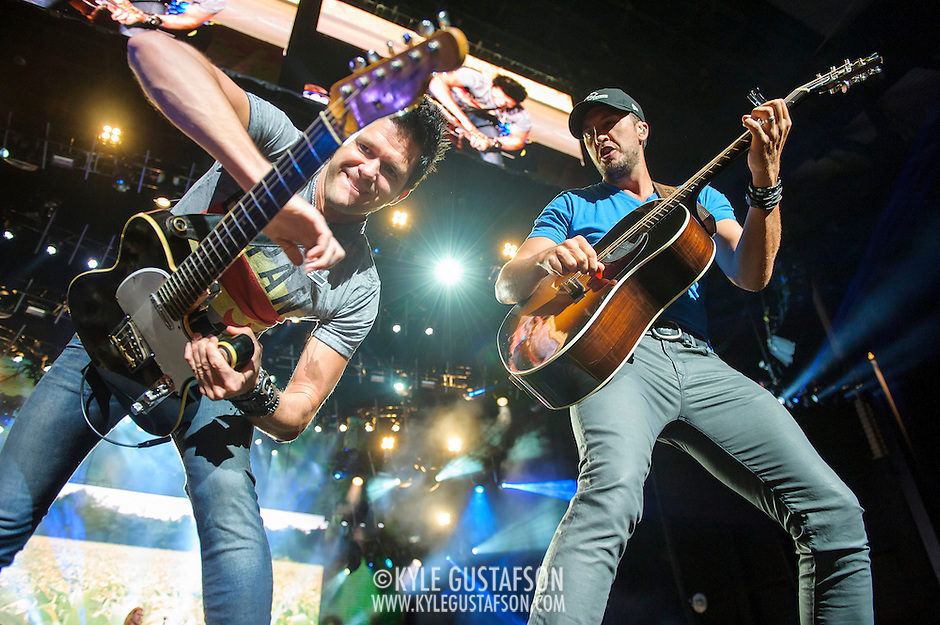 "BRISTOW, VA - May 30th 2014 - Guitarist Michael Carter and Luke Bryan trade guitar licks during a performance of Bryan's hit single ""Rain Is A Good Thing,"" at Jiffy Lube Live in Bristow, VA. (Photo by Kyle Gustafson / For The Washington Post) (Kyle Gustafson/For The Washington Post)"
