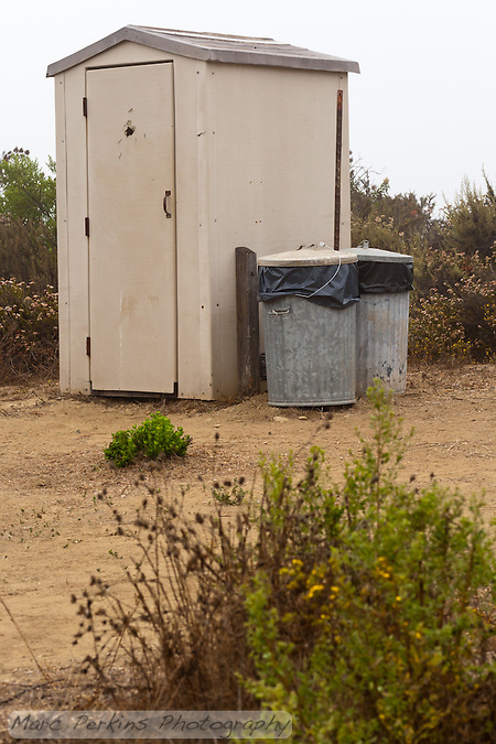 The pit toilet and trash cans at Crystal Cove State Park's Lower Moro campground. (Marc C. Perkins)
