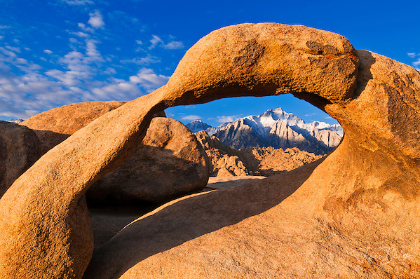 Dawn light on Lone Pine Peak through rock arch, Alabama Hills, Inyo National Forest, California USA (Russ Bishop/Russ Bishop Photography)