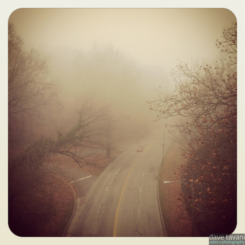 A single car drives north on Lincoln Drive in the fog, as seen from the Walnut Lane Bridge on December 2, 2012. (Dave Tavani)
