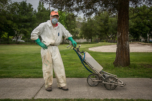 "Volunteer Dick Engelhard prepares to spray the greens at the Calistoga Golf Course.  ""This is perfect...no one will ever recognize me."" (Clark James Mishler)"