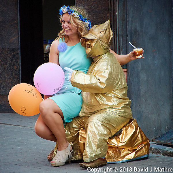 """Come Sit on My Lap Little Girl"" said the Man in Gold. Street Performer in Riga, Latvia. Image taken with a Nikon 1 V2 camera and 10-100 mm VR lens (ISO 400, 94.2 mm, f/5.6, 1/200 sec). Semester at Sea Spring 2013 Enrichment Voyage. (David J Mathre)"