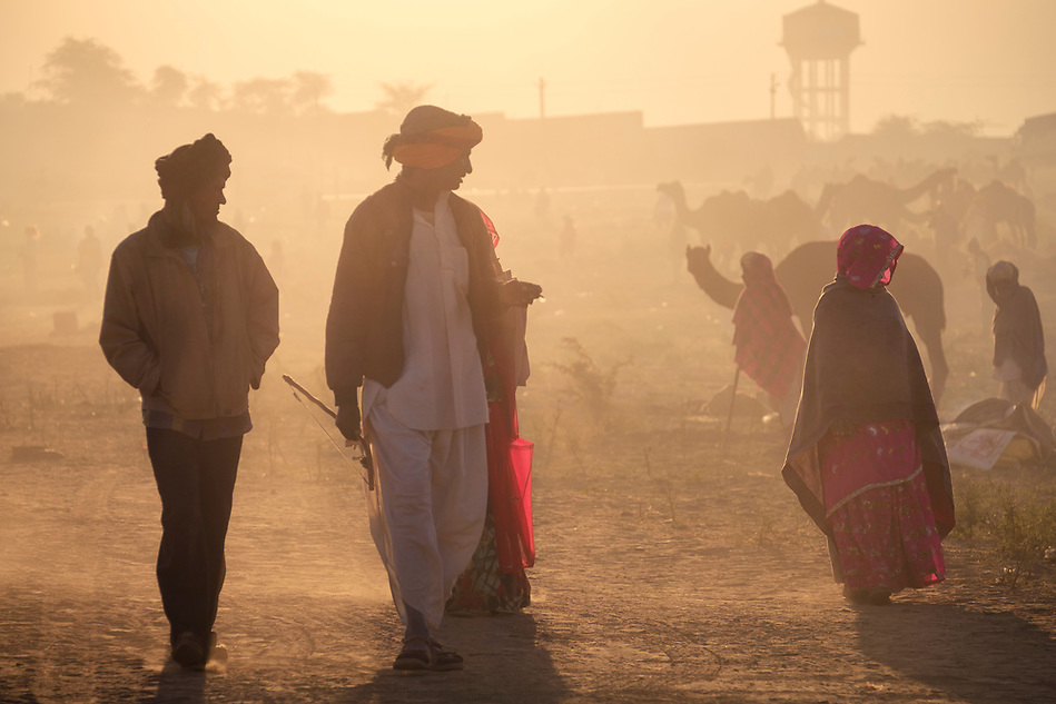 PUSHKAR, INDIA - CIRCA NOVEMBER 2016: People wailking early morning in the Pushkar Camel Fair grounds. It is one of the world's largest camel fairs. Apart from the buying and selling of livestock, it has become an important tourist attraction. (Daniel Korzeniewski)