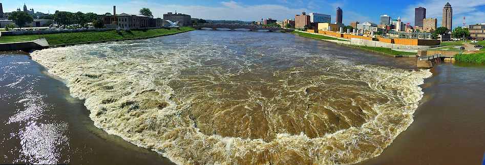 High water flows over the Center Street dam on Tuesday, July 1, 2014. This photograph is a 180-degree panoramic composite of multiple images. (Christopher Gannon/The Register)