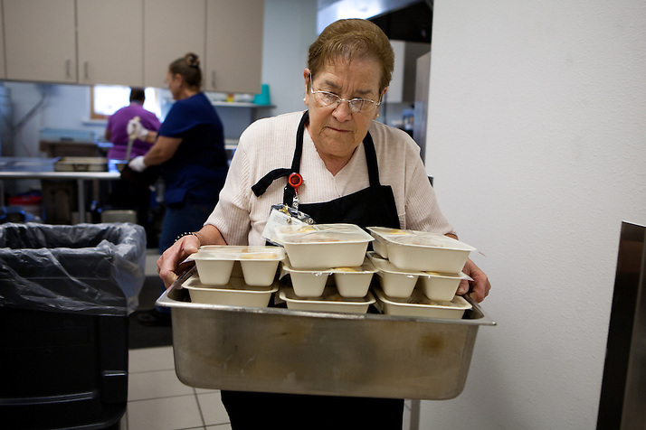 Bernis Chavez carries meals to be delivered to Torrance County senior citizens. New Mexico has received more than $601,000 for senior meals programs around the state. (Steven St. John)