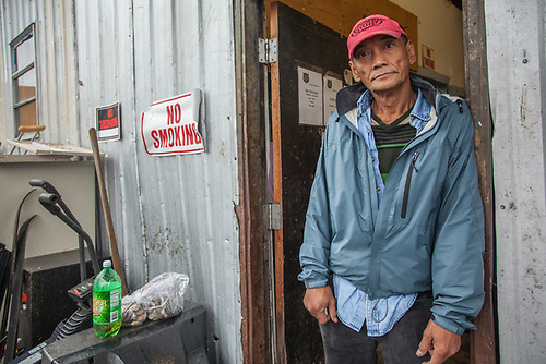 "Salvation Army worker Fernando Najarro awaits dropped off items at the company's Northern Lights Blvd. facility in Anchorage.  ""I've been working here for almost 90 days...I also do personal care work...I really like helping old people."" (© Clark James Mishler)"