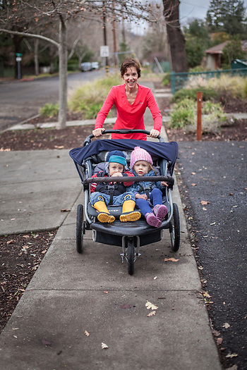 """They are the terrible twos, times two...strapping them in is the only way I can contain them.""  Christina Dwyer with her two year old twins, Dakota and Cindy, on Cedar Street in Calistoga, CA  tinajulian@yahoo.com (© Clark James Mishler)"