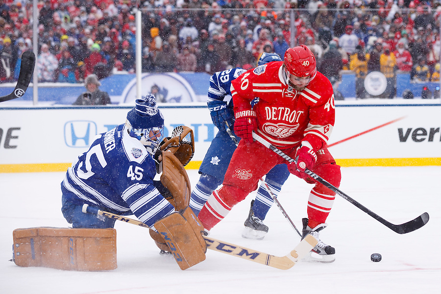 Jan 1, 2014; Ann Arbor, MI, USA; Toronto Maple Leafs goalie Jonathan Bernier (45) makes a save on Detroit Red Wings left wing Henrik Zetterberg (40) during the 2014 Winter Classic hockey game at Michigan Stadium. Mandatory Credit: Rick Osentoski-USA TODAY Sports (Rick Osentoski/Rick Osentoski-USA TODAY Sports)