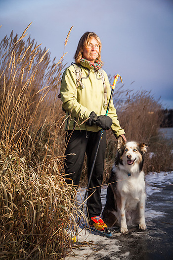 King Career Center teacher Assistant, Becky Crandall, with her dog, Gus, take their first skate of the season on Westchester Lagoon, Anchorage (Clark James Mishler)