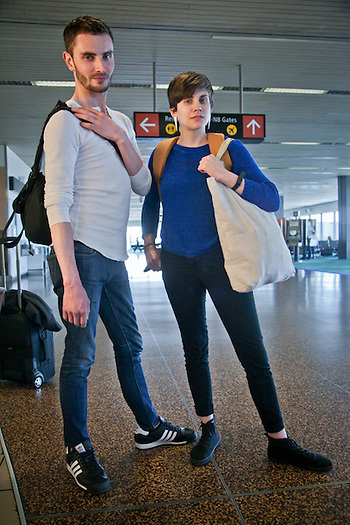 Jon Joseph and Melissa Shea await their flight to Thailand at the Seattle Tacoma Airport. (Clark James Mishler)