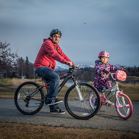 Phillip Samuelson and his daughter, Rivera Wilson, at Westchester Lagoon, Anchorage (Clark James Mishler)