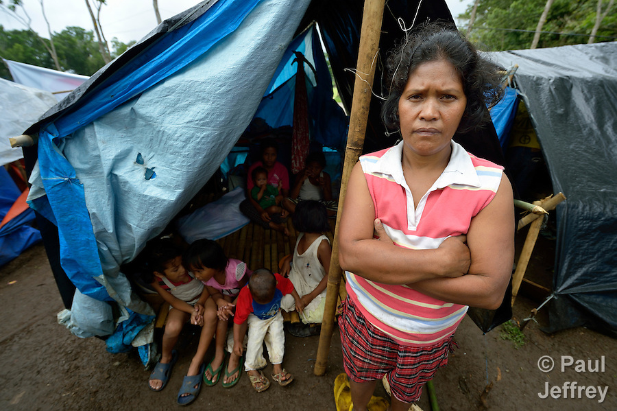 Sharon Liguyon, 44, is one of almost 200 residents of the indigenous village of San Fernando who fled their home on March 14, 2012, shortly after the March 5 assassination of her husband Jimmy Liguyon, the baranguay captain. Mr. Liguyon was killed by a paramilitary squad led by Aldy Salusad, which was angered by Liguyon's refusal to sign papers ceding the community's land to a large mining company. Convinced they were also in danger from Salusad and his military allies, his widow and other community members fled to the provincial capital of Malaybalay, where they have set up temporary shelters on the grass in front of provincial offices. They promise not to leave until there is justice in the killing of Liguyon..
