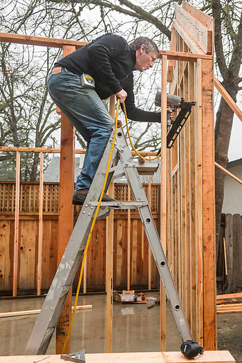 Joe Cabral constructs a small building  in Donna Homer's back yard on Myrtle Street in Calistoga. (Clark James Mishler)