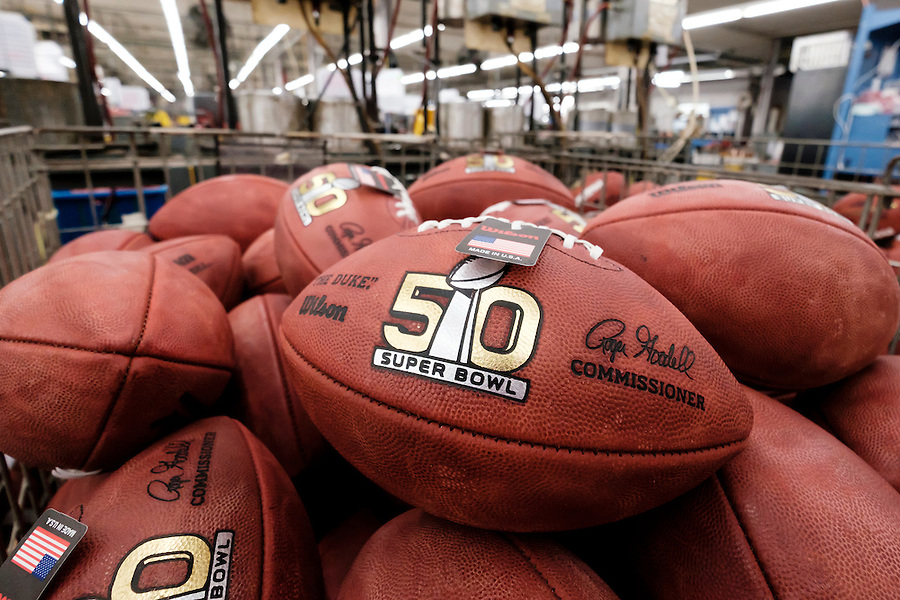 Official balls for the NFL Super Bowl 50 football game are seen in a bin prior to final inspection at the Wilson Sporting Goods Co. in Ada, Ohio, Tuesday, Jan. 26, 2016. The Denver Broncos will play the Carolina Panthers in the Super Bowl on Feb. 7 in Santa Clara, CA. (AP Photo/Rick Osentoski) (Rick Osentoski/AP)