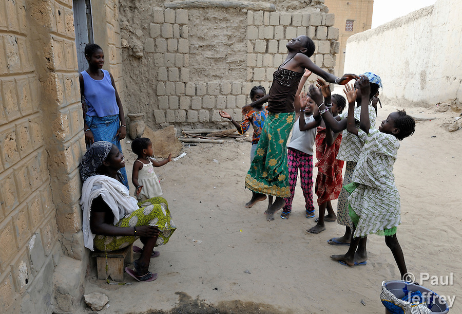Girls playing in the street in Timbuktu, the northern Mali city that was seized by Islamist fighters in 2012 and then liberated by French and Malian soldiers in early 2013. During the jihadists' rule, women and girls were not allowed in public unless they were completely covered. (Paul Jeffrey)