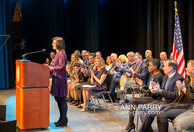 """""""Hempstead, NY, U.S. January 1, 2018. SYLVIA CABANA, at podium, speaks after being sworn in as Hempstead Town Clerk, and LAURA GILLEN, just sworn in as Hempstead Town Supervisor, sits at left in front row with family, at Hofstra University. (© 2018 Ann Parry/Ann-Parry.com)"""