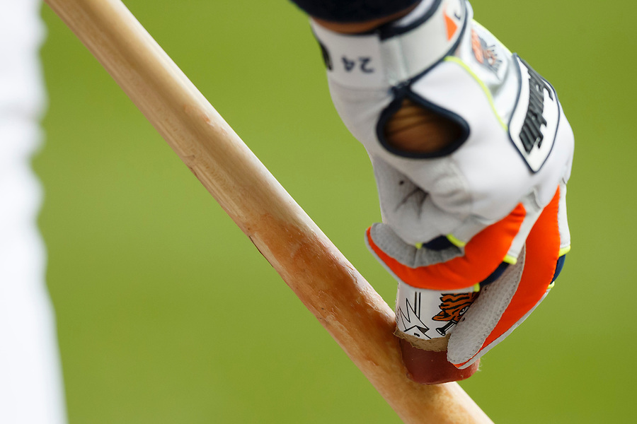 May 23, 2014; Detroit, MI, USA; Detroit Tigers first baseman Miguel Cabrera (24) uses a grip stick on his bat against the Texas Rangers at Comerica Park. Mandatory Credit: Rick Osentoski-USA TODAY Sports (Rick Osentoski/Rick Osentoski-USA TODAY Sports)