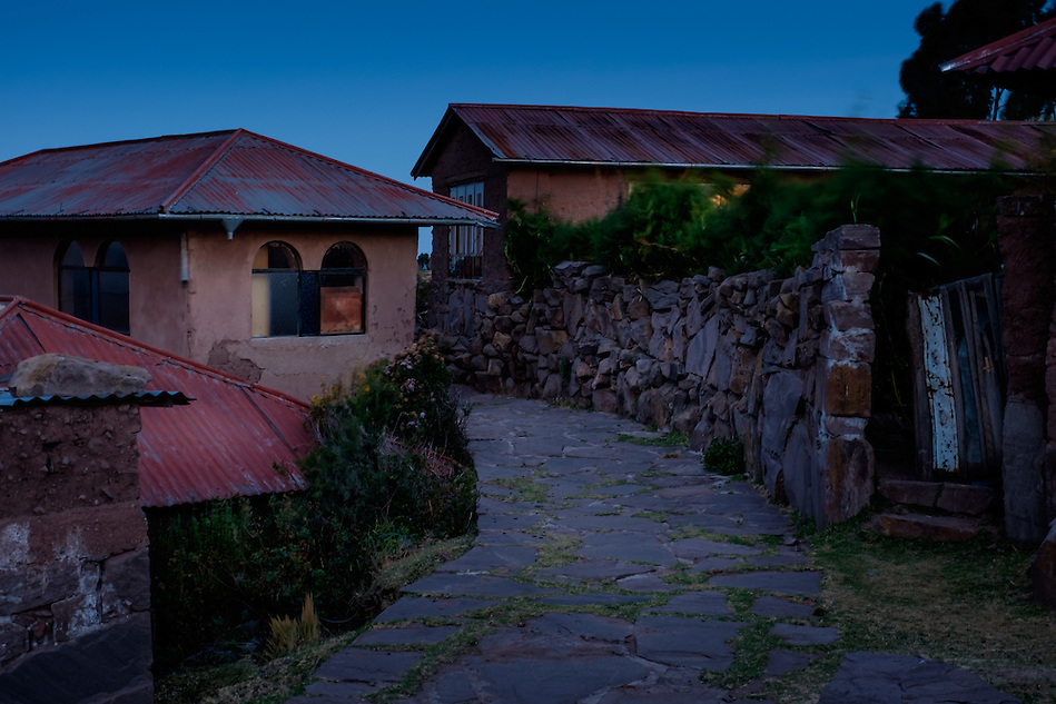 PUNO, PERU - CIRCA OCTOBER 2015: Typical houses of the Island of Taquile in Lake Titicaca at night. (Daniel Korzeniewski)