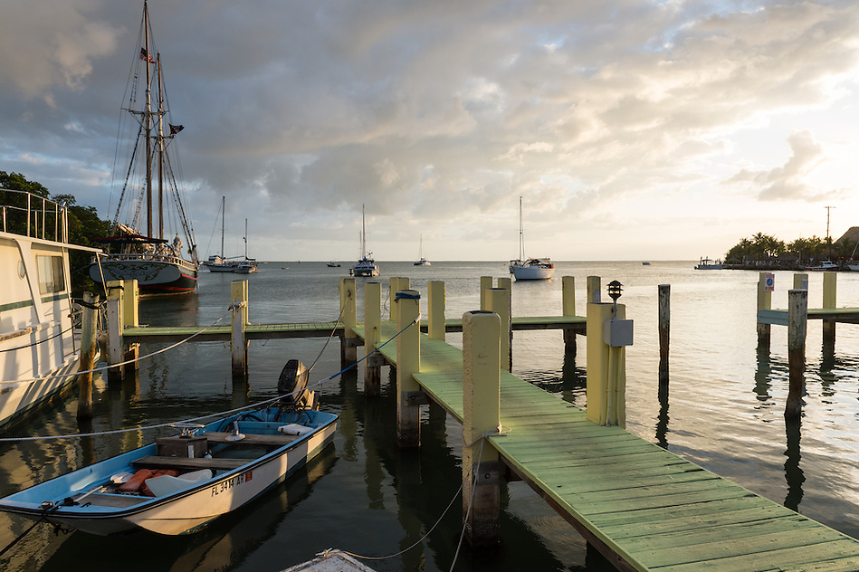 KEY LARGO, FL - CIRCA 2012: View of typical dock with boath in Key Largo circa 2012. The Florida Keys are a very popular tourist destination with over 2 million yearly visitors. (Daniel Korzeniewski)