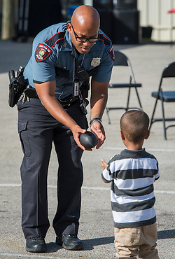 Houston ISD staff, vendors and community members participate in National Night Out activities at the Houston ISD Police Department, October 7, 2014. (Houston ISD/Dave Einsel)