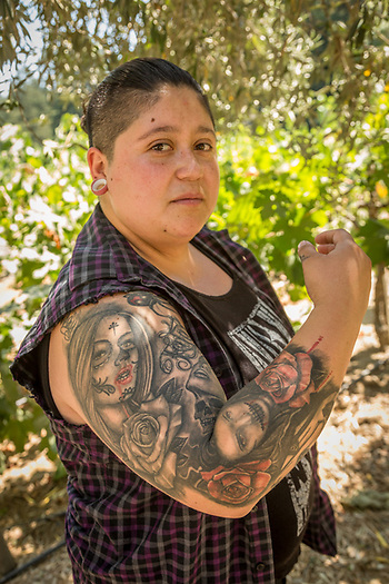 """I once worked for an embalmer...I actually love blood & guts.""  -Napa resident Alba Mendoza finds shade under the trees during  the hottest time of the day in Calistoga. (Clark James Mishler)"