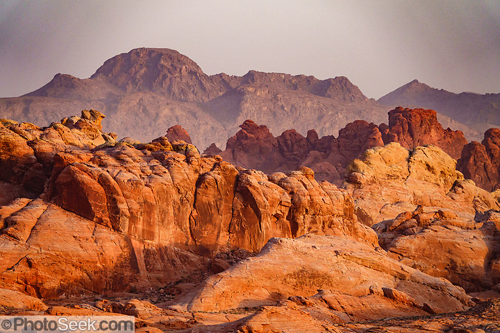 Valley of Fire State Park, Moapa Valley, Nevada, USA. Starting more than 150 million years ago, great shifting sand dunes during the age of dinosaurs were compressed, uplifting, faulted, and eroded to form the park's fiery red sandstone formations. (© Tom Dempsey / PhotoSeek.com)