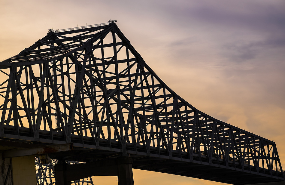 NEW ORLEANS - CIRCA FEBRUARY 2014: Structure of the Crescent City Connection over the Mississippi River in New Orleans at sunset. (Daniel Korzeniewski)