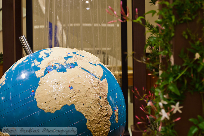 "A view of the braille world globe in Orange Coast College's Ornamental Horticulture Club's first-place winning garden installation at the 2012 South Coast Plaza Spring Garden Show in Costa Mesa, CA.  The theme for the show was ""healing gardens"", and the OCC team installed a ""garden for the visually impaired.""  The garden's centerpiece is a 1957 restored globe for the blind, with the world geography in exaggerated height to be sensed by the touch of blind people; the locations of plants in the garden was indicated in braille on the globe. (Marc C. Perkins)"