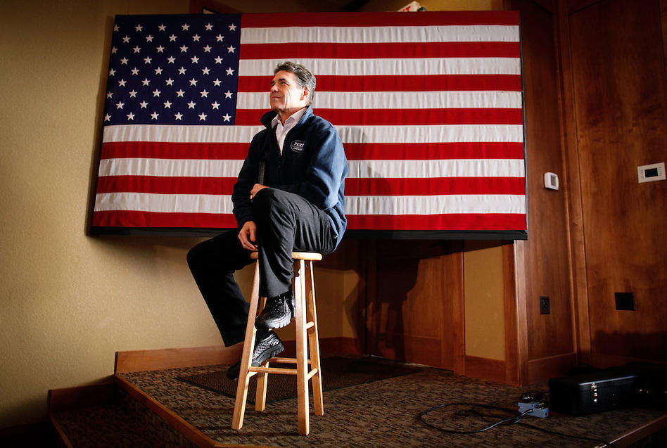 Rick Perry sits on a stool while being introduced at a campaign stop in Carroll, Iowa Monday, January 2, 2012.  (Christopher Gannon/GannonVisuals.com/MCT) (Christopher Gannon)