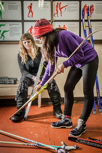 Karen Witthoeft teaches the fine art of ski waxing to a member of the cross country ski team at Central Middle School. (Clark James Mishler)